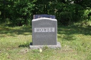 Mowing Grass in a Cemetery